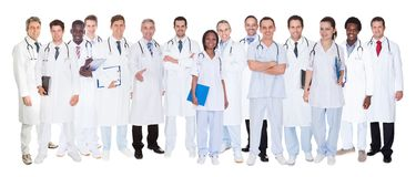 Confident doctors against white background Royalty Free Stock Image