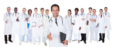 Confident doctors against white background Stock Images