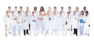 Confident doctors against white background Stock Image