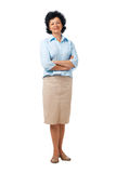 Confident Elder Woman Standing. Full length portrait of an elderly woman standing with folded hands Stock Photos