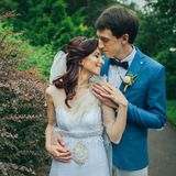 Confident elegant groom and beautiful shy bride holding hands ou stock photo