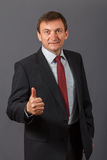 Confident elegant handsome mature businessman wearing a nice sui royalty free stock images