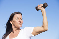Confident energetic sporty mature woman Stock Images