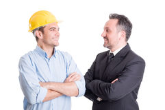 Confident engineer and business man face to face. Confident engineer and business men face to face smiling at each other Royalty Free Stock Photo