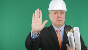 Confident Engineer Gestures Showing a Stop Hand Sign royalty free stock images