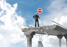 Confident engineer holding street safety sign. Royalty Free Stock Photo