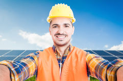 Confident engineer taking a self portrait. With ecologic panels in background Stock Images