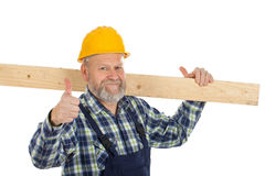 Confident engineer at work. Picture of a confident engineer holding a lath showing thumbs up royalty free stock image
