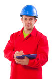 Confident engineer writing in clipboard isolated o Royalty Free Stock Photography