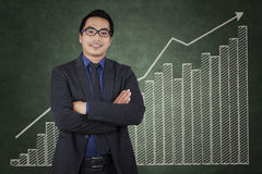 Confident entrepreneur with business growth chart Royalty Free Stock Images