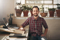 Confident entrepreneur designer sitting in his office space Royalty Free Stock Photography