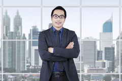 Confident entrepreneur standing in office Stock Photography