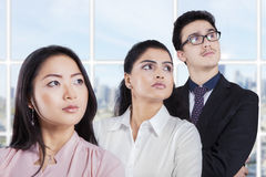Confident entrepreneurs standing in a row Stock Photo