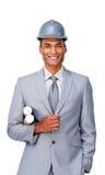 Confident ethnic architect wearing a hardhat stock photography