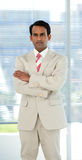 Confident ethnic businessman with folded arms Stock Photo
