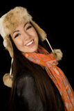Confident ethnic teen wearing winter scarf and hat Stock Images