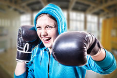 Confident excited sportsgirl in boxer gloves ready Stock Photos