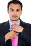confident executive adjusting his pink tie Royalty Free Stock Photo