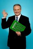 Confident executive holding calculator Royalty Free Stock Photos