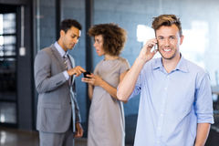 Confident executive talking on mobile phone Royalty Free Stock Photos