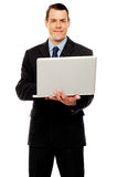 Confident executive using laptop and surfing web Stock Image