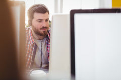 Confident executive working on computer at creative office Royalty Free Stock Photos