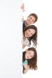 Confident family holding blank billboard Stock Image