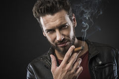 Confident fashionable man with cigar Royalty Free Stock Photography