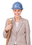 Confident female architect holding blueprints. Against a white background Royalty Free Stock Images