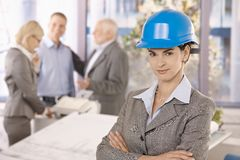 Confident female architect wearing hardhat Stock Photo