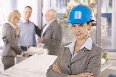 Confident female architect wearing hardhat Stock Photo