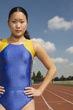 Confident Female Athlete On Racing Track royalty free stock photography