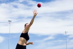 Confident female athlete throwing shot put ball Royalty Free Stock Photography