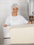Confident Female Baker With Big Bread Loaf In Royalty Free Stock Photo