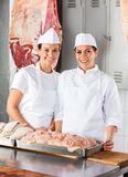 Confident Female Butchers At Counter Stock Photography
