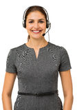 Confident Female Call Center Representative. Portrait of confident female call center representative standing against white background. Vertical shot Stock Photography