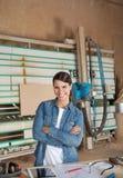 Confident Female Carpenter At Table Stock Photo