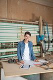 Confident Female Carpenter At Table Royalty Free Stock Photo
