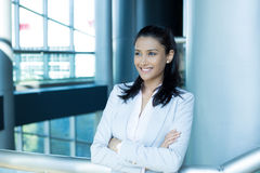 Confident female CEOs. Closeup portrait, young professional, beautiful confident woman in pink shirt gray suit, arms crossed folded, smiling  indoors office Royalty Free Stock Photo