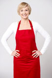 Confident female chef over grey Royalty Free Stock Photo