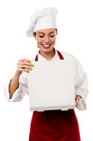 Confident female chef portrait. Young beautiful chinese female chef posing with confidence Stock Images