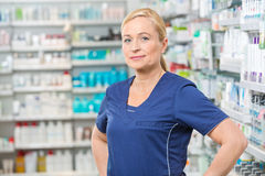 Confident Female Chemist Smiling In Pharmacy Stock Image