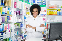 Confident Female Chemist Standing Arms Crossed. Portrait of confident female chemist standing arms crossed in pharmacy Royalty Free Stock Images