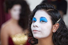 Confident Female Circus Performer. Serious young female cirque performer with white facepaint Stock Photography