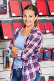 Confident Female Customer In Hardware Store Stock Photo