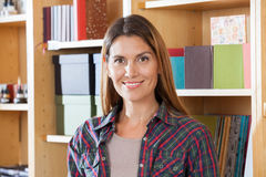 Confident Female Customer Smiling In Book Store Royalty Free Stock Photo