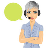 Confident female customer support phone operator with arms folded and speech bubble. Portrait of confident female customer support phone operator with arms Royalty Free Stock Photography