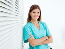 Confident Female Dentist In Clinic Royalty Free Stock Photo
