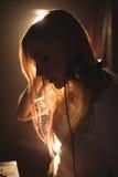Confident female DJ listening music on headphones. Close up of confident female DJ listening music on headphones Stock Photos