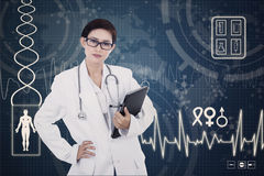 Confident female doctor on digital background Stock Photo